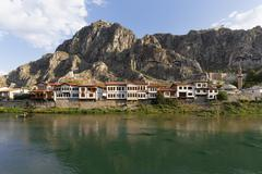 Stock Photo of Ottoman houses on the Yesilirmak river and Tombs of the Kings Amasya Black