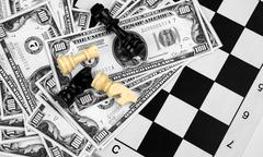 Money and Chess - stock photo