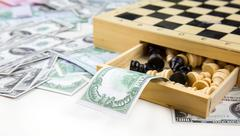 Money and Chess - stock photo