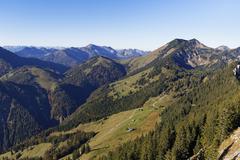 View from Mt Brunnstein HimmelmoosAlm mountain pasture Mt Grosser Traithen - stock photo