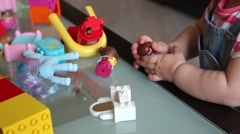 Small kid playing with constructor toy Stock Footage