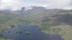 AERIAL Ireland-Through Mountains Towards Kenmare Stock Footage