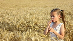 Beautiful girl in the wheat Stock Footage