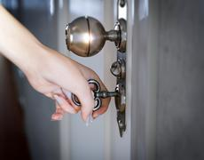 woman hand opening the door conceptual composition - stock photo