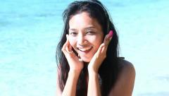 Woman with headphones singing on the sea Stock Footage