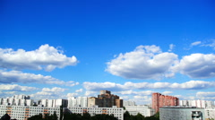 Clouds float above the houses Stock Footage