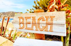 Signpost pointing to the beach in Ibiza Island, Spain, with a filter effect Stock Photos