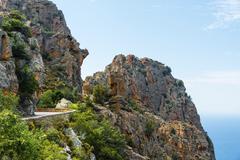 Stock Photo of Road through bizarre rock formations Calanche of Piana Calanques de Piana Gulf