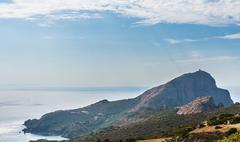 Genoese tower coast and mountains Gulf of Porto Corsica France Europe Stock Photos