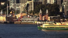 Stock Video Footage of Sydney Harbour fun fair with boat passing by
