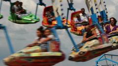 People enjoying the carousel ride Stock Footage