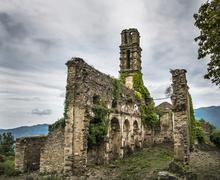 Former Franciscan Monastery of Orezza ruins of a church in front of a dramatic - stock photo