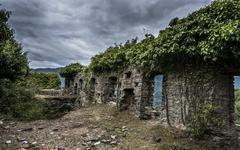 Ruins of the church of Santa Maria di Riscamone against dramatic sky Valle - stock photo