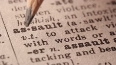 Assault - Fake dictionary definition of the word with pencil underline Stock Footage