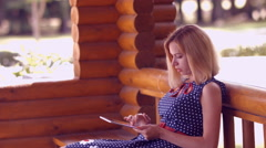 Girl working on a tablet computer in the park Stock Footage