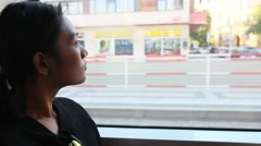 Woman traveling by tram Stock Footage