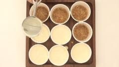 Cup cake base being spread with cream cheese Stock Footage