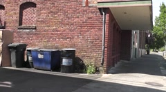 Trash Containers In An Alley Stock Footage