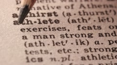 Athlete - Fake dictionary definition of the word with pencil underline Stock Footage