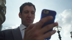 4k happy businessman video messaging client Stock Footage