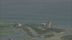 AERIAL France-Etang De L'Ayrolle And Ruined Watchtower - stock footage