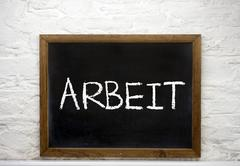 Chalkboard with the word Arbeit German for work - stock photo