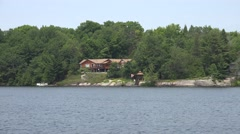 Lxury summer home on a rocky shore Stock Footage