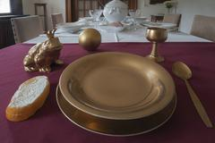 Frog next to a golden plate on the table depiction from the fairy tale The Frog Stock Photos