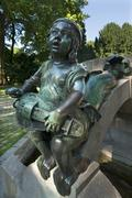 Stock Photo of Childs sculpture with musical instrument and fish fin on Minnesangerbrunnen