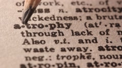 Atrophy - Fake dictionary definition of the word with pencil underline - stock footage