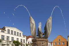 Fish fountain spouting water Barth Mecklenburg Western Pomerania Germany Europe - stock photo