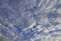 Layer of fluffy clouds altocumulus clouds - stock photo