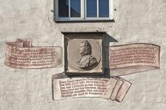 Relief at the Goldenes Kreuz house of John of Austria Haidplatz Regensburg - stock photo