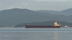 Cargo ship in English Bay, early morning, Vancouver BC Stock Footage