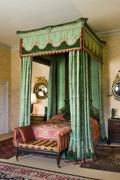 Vintage antique four poster bed with curtains and drapes - stock photo