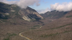 AERIAL United States-Flight Climbing Over Pass In Franconia Notch State Park Stock Footage