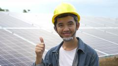 Asian engineer walking to check solar panel setup - stock footage