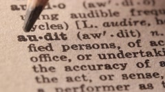 Audit - Fake dictionary definition of the word with pencil underline - stock footage