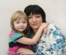 Girl 5 years hugging her mother 35 years - stock photo