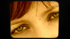 Beautiful Green Eyes Of Dark Haired Woman Looking Into Camera Stock Footage