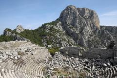 Ruins of the amphitheatre ancient city Termessos Antalya Province Turkey Asia - stock photo