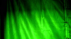Mysterious lights behind curtain at night Stock Footage
