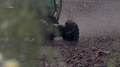 Tractor plowing the land 4 Stock Footage