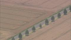 AERIAL Germany-Lone Car Crossing Expanse Of Farmland Stock Footage