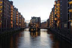 Speicherstadt warehouse district moated castle Blue Hour HafenCity Hamburg Stock Photos