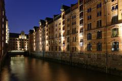 Speicherstadt warehouse district night scene HafenCity Hamburg Germany Europe Stock Photos