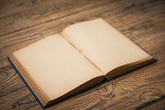 Open blank pages of old book on wood background Stock Photos