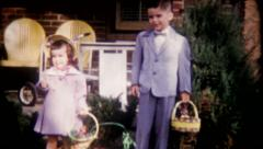 2302 - children dressed for Easter pose for photos - vintage film home movie Stock Footage