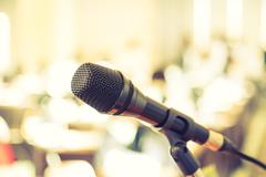 Black microphone in   conference room ( Filtered image processed vintage effe Stock Photos