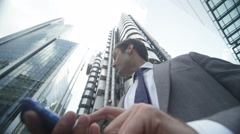 4k, Successful businessman texting on mobile phone in London financial district Stock Footage